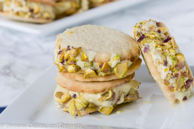 Pistachio Ice Cream Sandwich Cookies - creamy homemade pistachio ice cream sandwiched between soft buttery, sugar cookies, and rolled in chopped pistachios.