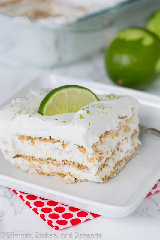A piece of key lime ice box cake with a fork