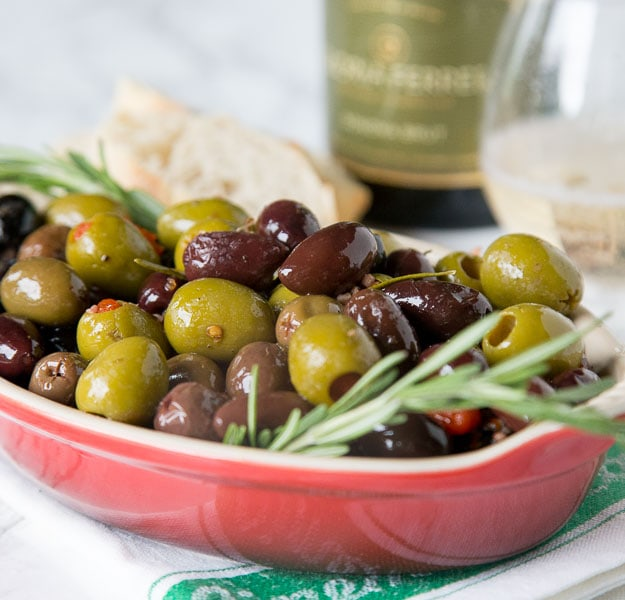 A bowl of olives and herbs