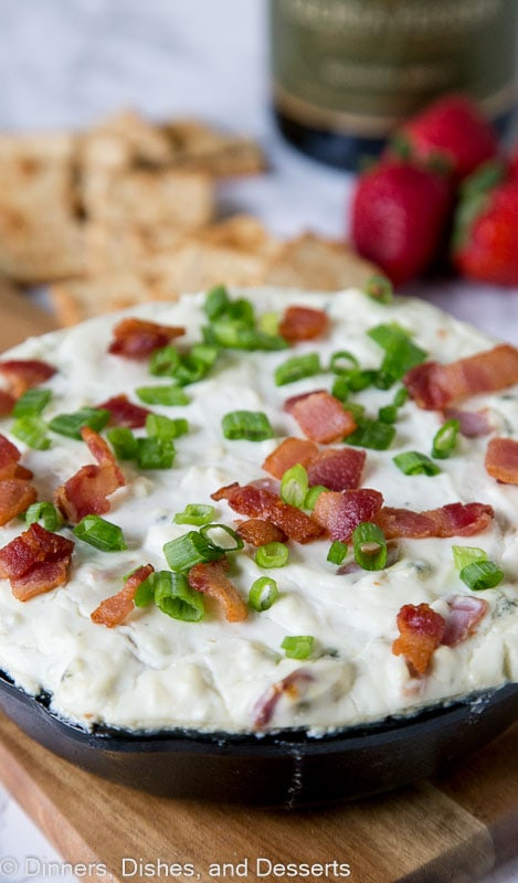 Baked Blue Cheese Dip - a creamy cheese dip recipe with bacon and lots of blue cheese. Warm, gooey, and great for parties!