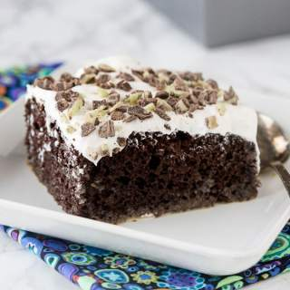 Irish Cream Chocolate Poke Cake - a tender chocolate poke cake spiked with Irish Cream and topped with whipped cream!