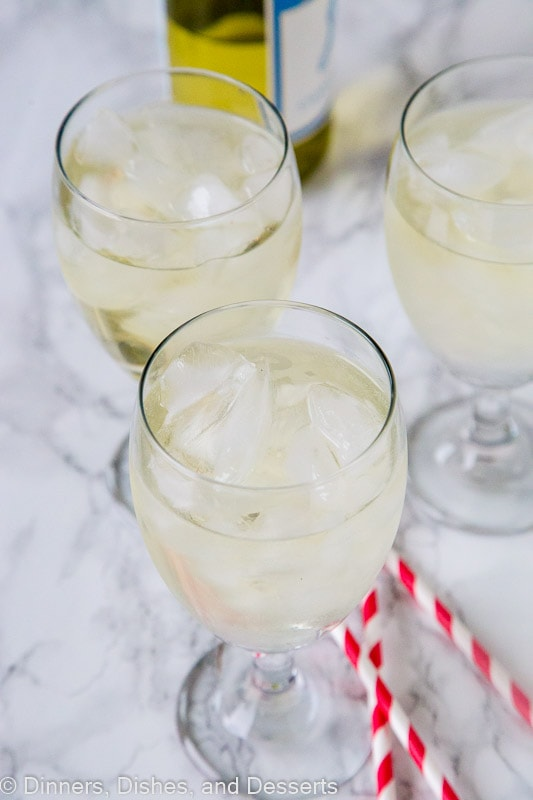 White Wine Spritzer Recipe - a cool and refreshing cocktail you can enjoy anytime of day! So easy, you can make in minutes, with just 2 ingredients!