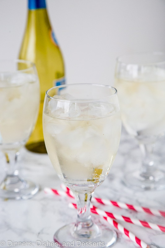 A glass of wine, with Spritzer and White wine