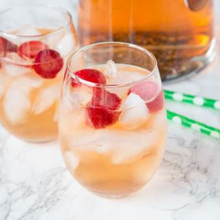 Strawberry Rum Punch Recipe - a fun cocktail with strawberries, white rum, ginger ale and strawberry sparkling wine. Fizzy, refreshing and great for any occasion.