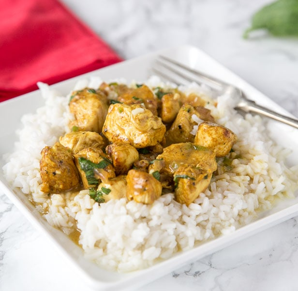 Basil Coconut Chicken Curry - chicken curry made with coconut and lots of fresh basil. Ready in minutes, super easy, and great for any night of the week.