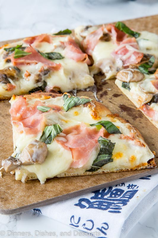 Mushroom and Ham White Pizza - roasted garlic white sauce with sauteed mushrooms, cheese, and ham make for a delicious pizza. Great way to use what you already have on hand!