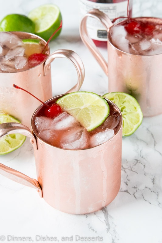 Cherry Lime and Moscow mule in a glass with lime slices