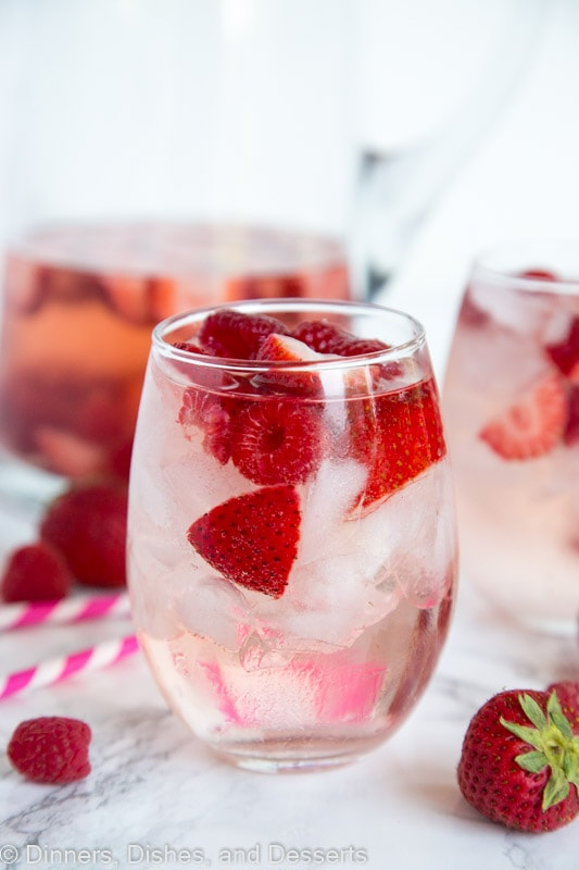 Berry Rosé Sangria - Use Rose wine to make this refreshing and easy sangria for summer. Loaded with raspberry and strawberries for a great summer cocktail.