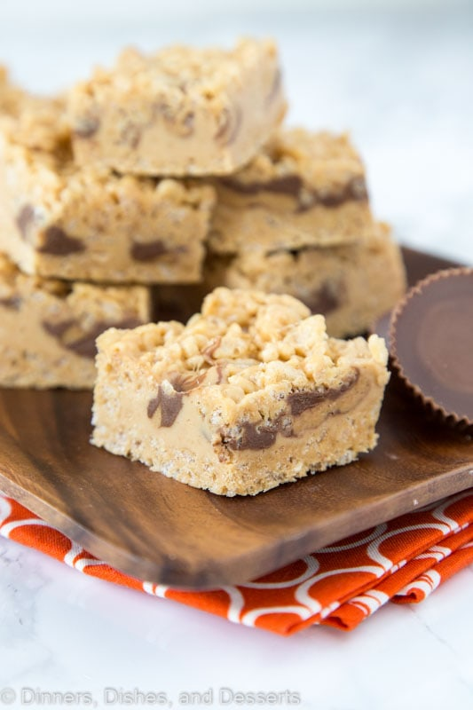 krispie treats with peanut butter and peanut butter cups on tray