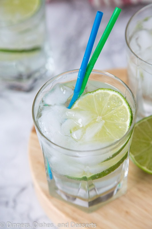 Gin and Tonic - a great way to enjoy your favorite gin. A cool and refreshing cocktail with gin, tonic water and lime wedges.