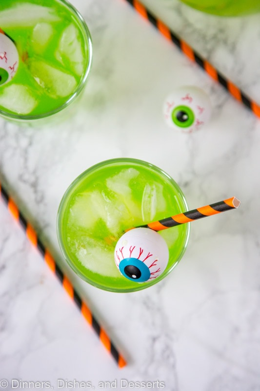 A cup of green Hawaiian punch with plastic eyeball for Halloween