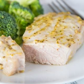 A close up of a plate of food with broccoli, with Pork