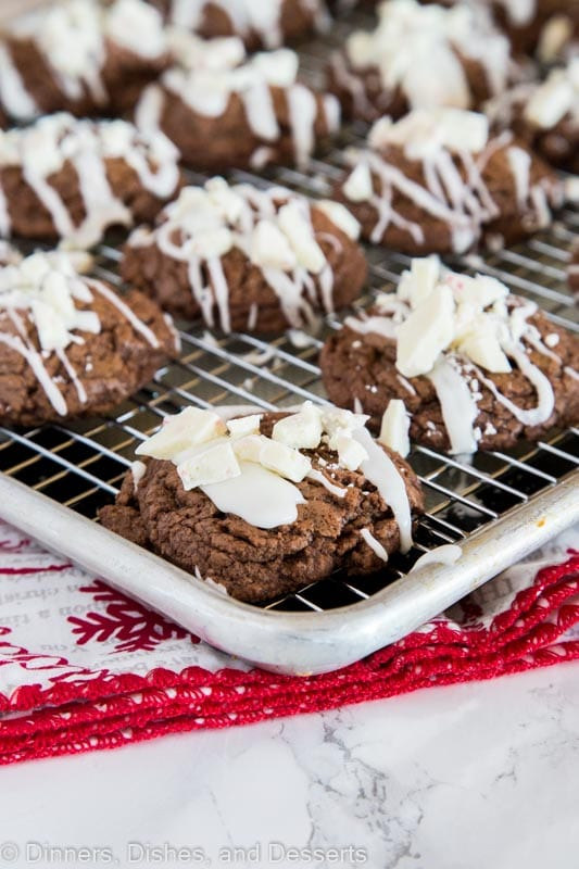Chocolate Peppermint Cookies - these chocolate cookies have a hint of peppermint and are super fudgy. They are topped with a white peppermint glaze and more peppermint candies.