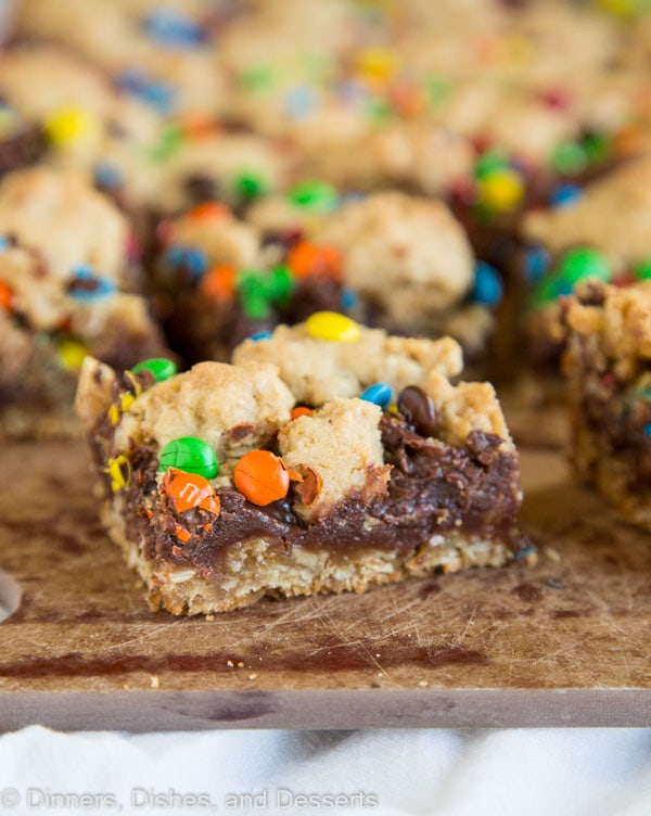 M&M Chocolate Oat Bars - brown sugar oatmeal cookie base with a layer of chocolate fudge in the middle and topped with M&M's. A delicious treat for any occasion.