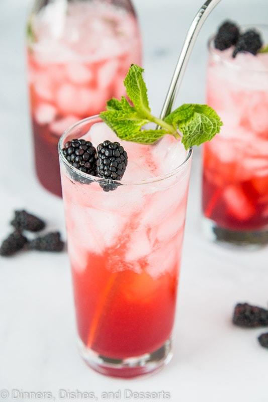 Blackberry Lime Punch in tall glass with mint and fresh blackberries