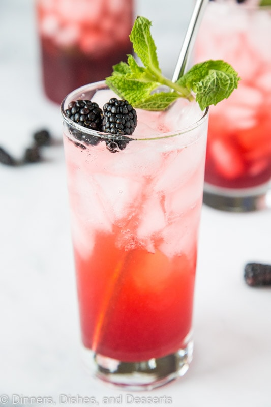 Blackberry Lime Punch front and center topped with mint and fresh berries