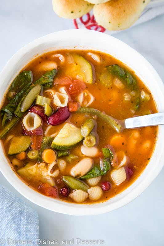 A bowl of hearty minestrone soup with shell pasta, and tons of veggies