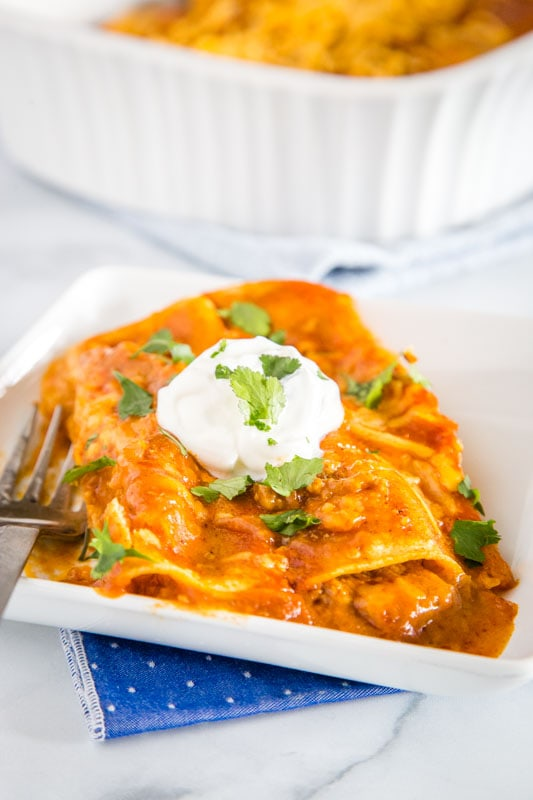 Enchiladas are a Mexican favorite and super easy to make at home.  These are filled with ground beef, cheese and onions