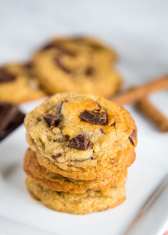 A close up of cookies on a plate, with Cookie and Chocolate chip