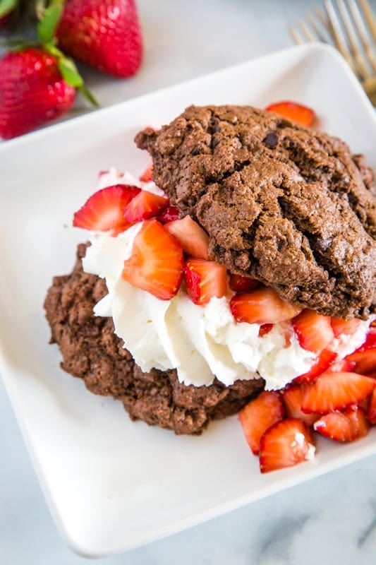 Chocolate strawberry shortcake with fresh whipped cream and lots of strawberries