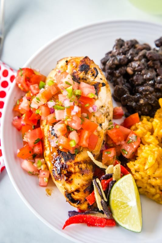 grilled chicken on plate with black bean and rice
