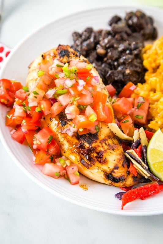 margarita chicken with pico de gallo served with black beans and mexican rice