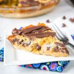 Samoa Cookie Pie - The classic Girl Scout Samoa Cookies in the form of a pie! Butter cookie crust topped with chocolate, caramel and toasted coconut.