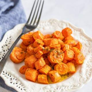 cooked carrots on a plate with fork