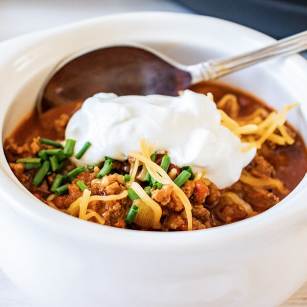 close up of turkey chili in white bowl