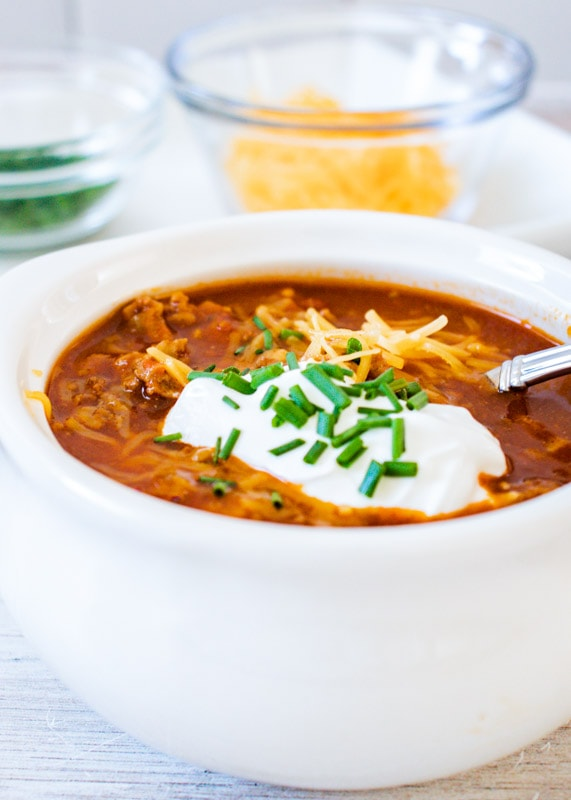 turkey chili in bowl with a spoon