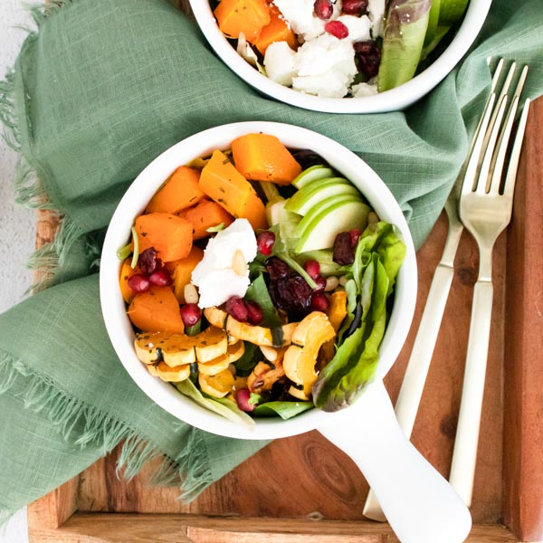 cropped in of squash salad in white bowl