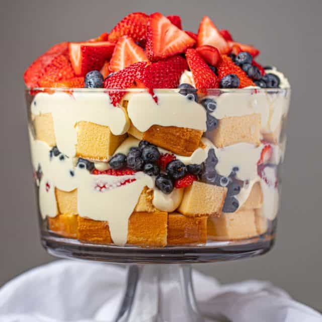 Classic Trifle with strawberries and blueberries in large trifle dish