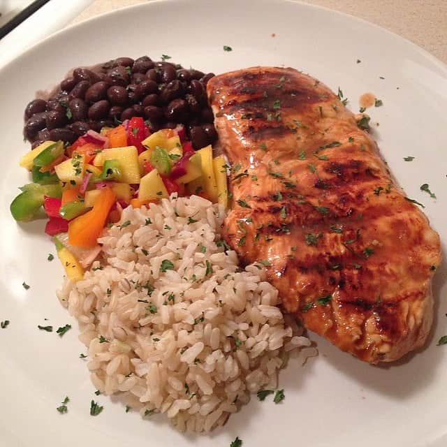 Cajun Grilled Chicken with mango salsa, black beans, and brown rice
