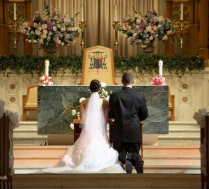 Bride and groom at church wedding altar ceremony