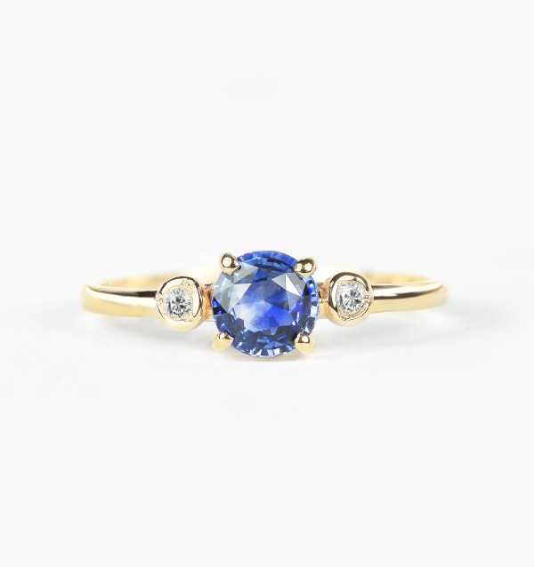 blue sapphire engagement ring made in yellow gold