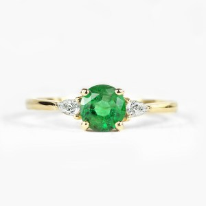 emerald engagement ring with pear cut diamonds