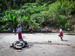 Kalau datang sebelum siang, lapangan yang biasa digunakan sebagai area parkir masih dipakai anak-anak sekolah bermain sepak bola.