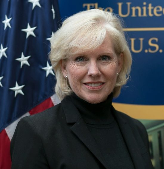 Portrait of Mary Kane in front of the National Museum of American Diplomacy banner