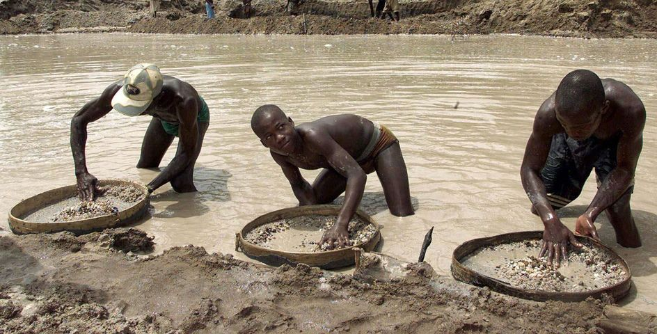 Diamond prospectors sift the earth in Sierra Leone. Wealth buried in the dirt drives civil wars that have killed and maimed tens of thousands of innocent civilians.