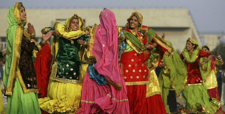 """Punjabi girls perform """"Giddah,"""" a traditional folk dance, during the inaugural ceremony of the 14th National Youth Festival in Amritsar, India."""