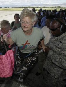 U.S. citizens board a U.S. Air Force cargo plane headed to Miami from Port-au-Prince, Haiti.