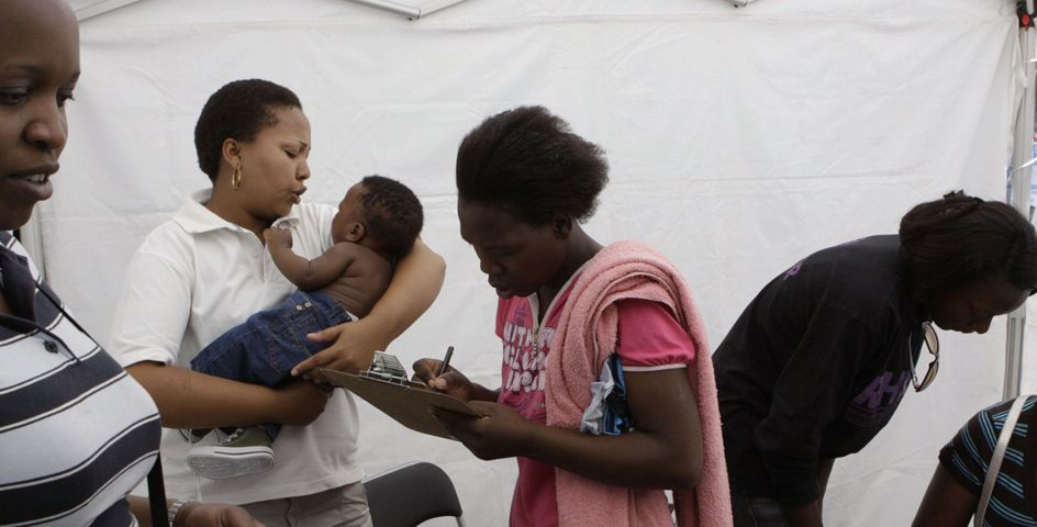 A woman signs a consent form at a mobile healthcare clinic in Johannesburg, South Africa.
