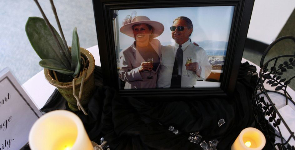 At a memorial service in California, candles surround a photograph of Scott and Jean Adams, two Americans shot to death by Somali pirates.
