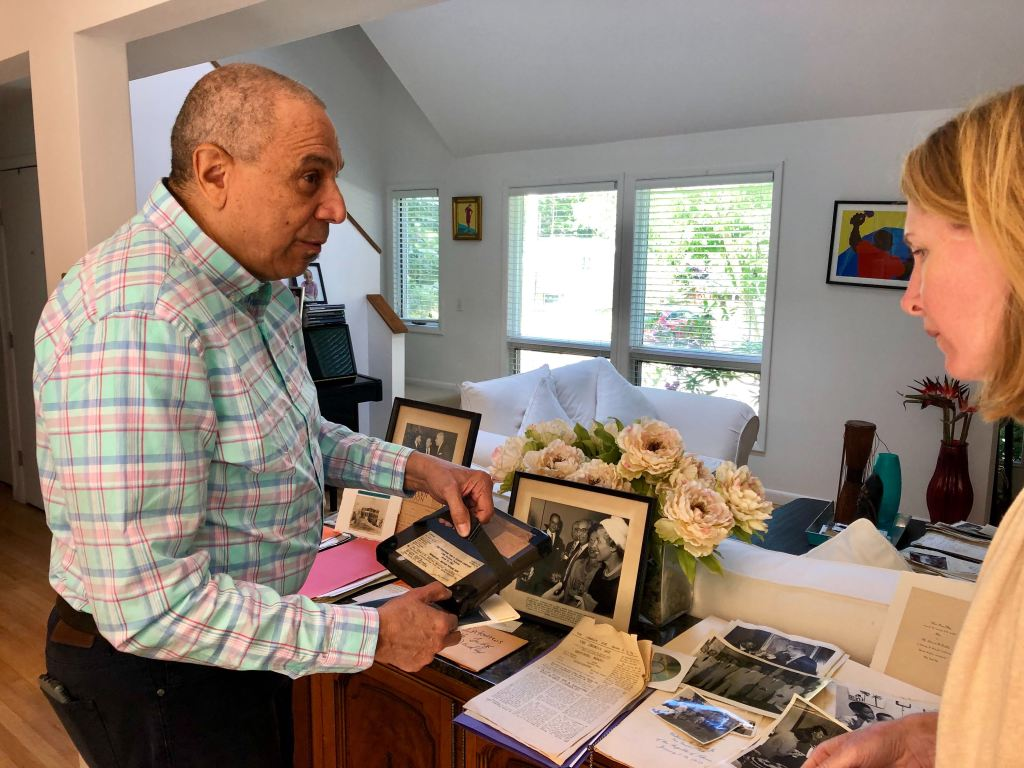Edward Dudley Jr. and Diplomacy Center Associate Curator Katie Speckat discuss items in his father's diplomatic collection.