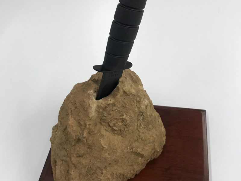 This dagger in fake stone was given to Secretary Clinton by the U.S. Special Operations Command to commemorate the capture and killing of Osama Bin Laden in 2011. Secretary Clinton displayed this gift on the bookshelf in her office. Collection of the National Museum of American Diplomacy.