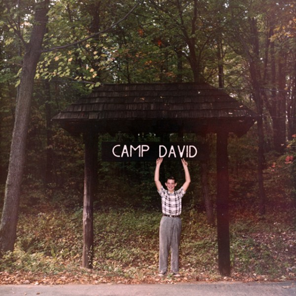 President Eisenhower named Camp David after his grandson. David poses in front of the entrance in 1960.