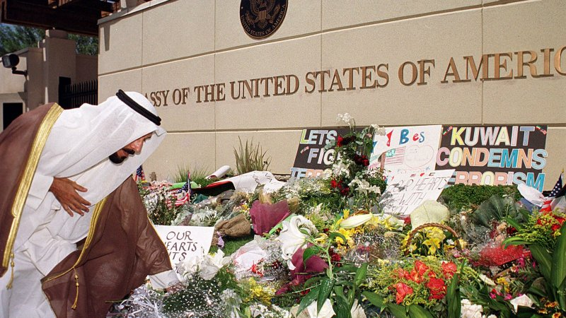 Sheikh Ali Jaber Al Sabah, Mayor of Jahra City and son of the Amir of Kuwait, lays flowers at the U.S. Emba