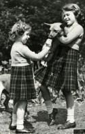 Princesses Elizabeth and Margaret Rose with corgi