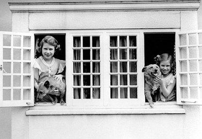 Princesses Elizabeth and Margaret Rose with corgis