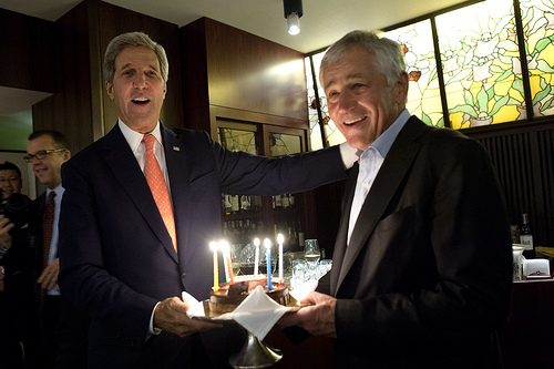 Secretary of State John Kerry, left, surprises Secretary of Defense Chuck Hagel with a birthday cake in honor of Hagel's Oct. 4 birthday in Tokyo Oct. 3, 2013. During their visit Hagel and Kerry and their Japanese counterparts met to discuss issues of mutual importance. (DoD photo by Erin A. Kirk-Cuomo/Released)